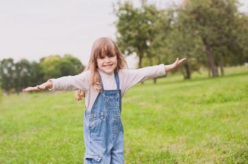 Cute little girl walking in the park