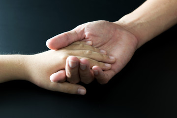 Father and child's hand