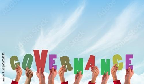 Fototapeta Composite image of hands holding up governance