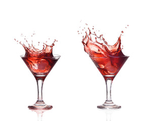 Red wine or alcohol cocktail splashing out of glass