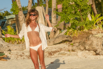 young happy beautiful woman enjoying summer vacation on tropical