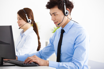 businessman and woman with headset working in office