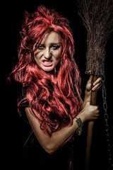Evil red-haired witch and her broomstick