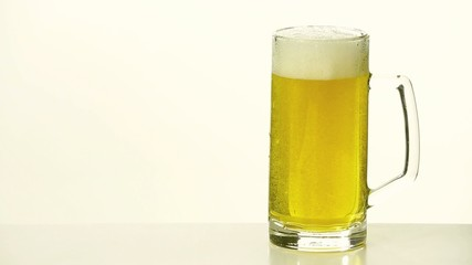 pouring of fresh beer on white