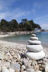 Stack of stones, Zen concept, on sandy beach