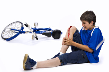 Young man who has had an accident in bicycle