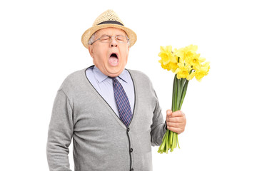 Senior having an allergic reaction to a bunch of tulips