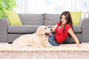 Young girl relaxing with her dog at home