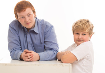 two boys brothers and friends  studio portrait white background