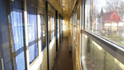 Empty corridor in a moving train.