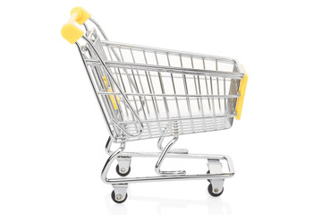 Yellow shopping supermarket cart on white, clipping path