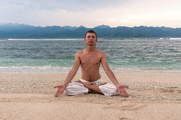 Man meditation on the beach