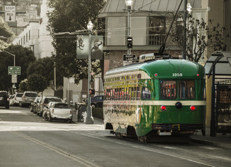 Vintage Overhead Cable Retro Trolley Car moves through street