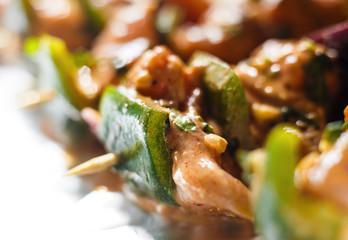 Chicken tikka. Raw chicken shashlik. Isolated on white