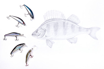 Fishing plastic baits with drawing fish on the white background.