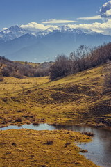 Spring scene with pond in Bucegi mountains valleys, Romania.