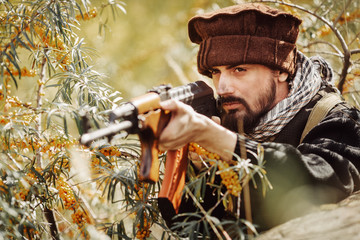 Portrait of serious middle eastern man with gun
