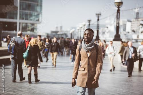 Fototapeta Man walking in London on Thames sidewalk