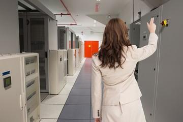Composite image of brunette businesswoman