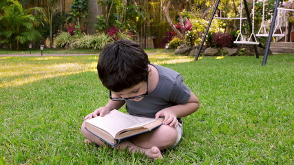 Kid With Glasses Reading Book