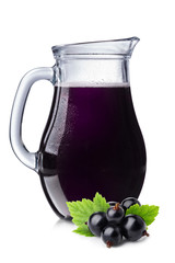 Fresh blackcurrant juice in a pitcher.