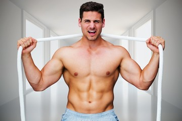 Composite image of handsome bodybuilder