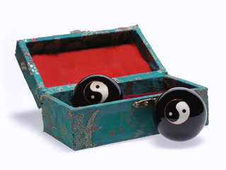 A box with a ball China Yin Yang. Traditional stress relief