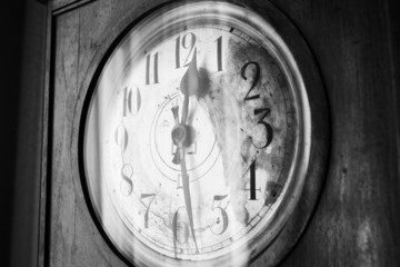 Antique grandfather clock, black and white photo, close up photo