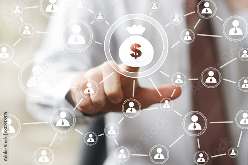 Leinwanddruck Bild Businessman pushing button web with dollar sign virtual.