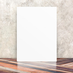 White Blank Poster in crack cement wall and diagonal wooden floo