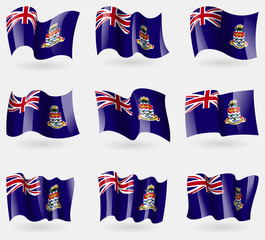 Set of Cayman Islands flags in the air. Vector