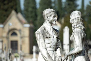 young lovers while smiling marble statue
