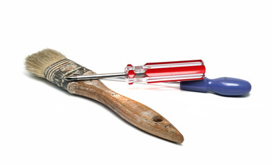 two screwdrivers and an old brush isolated on white background