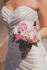 Beautiful wedding bouquet in bride's hand