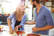 Young Couple Making Pizza In Kitchen Together - 80851824
