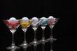 Leinwandbild Motiv Five glasses of champagne and golf tees