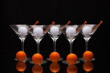 Five glasses of champagne and golf balls