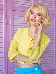 Beautiful blonde woman in fashionable bright cloth