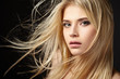 Portrait of blonde girl with fluttering hair - 80853210