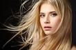 Leinwanddruck Bild - Portrait of blonde girl with fluttering hair