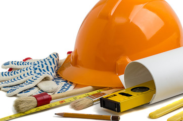 Construction helmet and tools on a white background