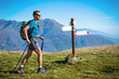 Trekker at crossroad. Italian Alps. - 80853604