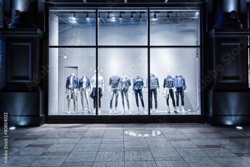 Fototapeta fashion shop display window and clothes.