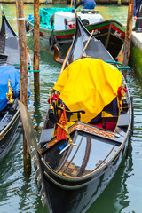 A beautiful gondola waiting for tourists floating on the water