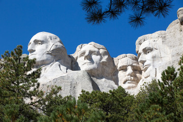 Presidents on Mount Rushmore framed by trees