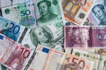Chinese, American and European paper currencies background
