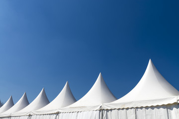 White tent on blue sky