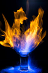 Fire cocktail on black background
