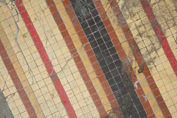 Close up of a worn Tile floor Full Frame