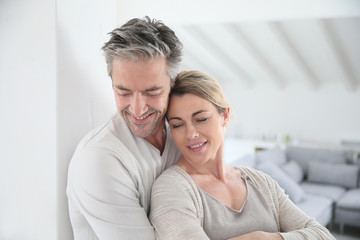 Portrait of mature couple embracing each other